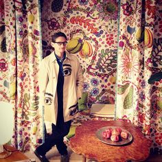 Hamish Bowles shopping in Stockholm. in a space surrounded by Josef Frank's BRAZIL pattern. Photo by vogue magazine