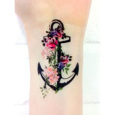 Pink & red flowered tattoo.