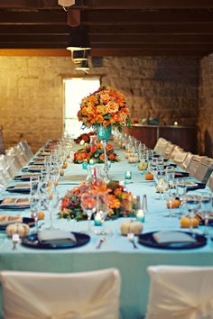 Table Setting Idea- turquoise table cloth or runner with coral/peach flowers