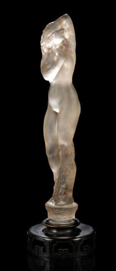 René Lalique  'Grande Nue Socle Lierre' a Statuette, design 1919  frosted glass, heightened with sepia staining, on a carved wood stand  41cm high, engraved 'R. Lalique'