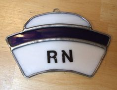 Vintage Cut Stained Leaded Glass RN Registered Nurse's Amulet Pin by MarksVintageShoppe on Etsy, $10.00