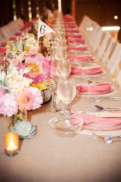 Pink on grey with doily placemats and fun florals.