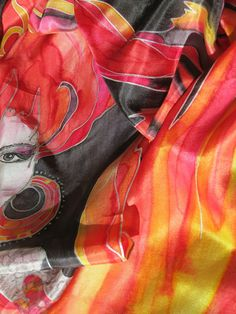 "Unique hand painted silk scarf "" Like a FIRE"" in red, orange, black and gold. With a WOMAN with the burning heart. Uniquie shape with flames..."