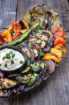 Marinated grilled vegetables with whipped goat cheese - eggplants, peppers, zucchini, asparagus, and onions, marinated and grilled till soft on the inside and charred on the outside, then doused in garlicky marinade, and served with whipped goat cheese on