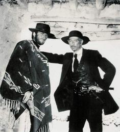 FOR A FEW DOLLARS MORE - Lee Van Cleef poses with Clint Eastwood on location in Spain - Directed by Sergio Leone - Publicity Still.