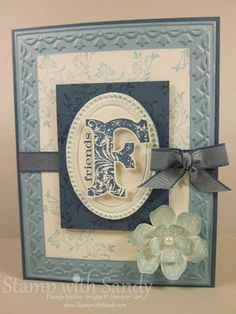 Stampin' Up! Products Used:  Stamp Sets: Vintage Vogue  Card Stock: Baja Breeze, Not Quite Navy, Very Vanilla  Ink Pads:Baja Breeze, Not Quite Navy  Tools: Big Shot, Designer Frames Embossing Folder, Framed Tulips Embossing Folder, Extra Large Oval Punch, Sponge Daubers  Accessories: Not Quite Navy Taffeta Ribbon, Pearls