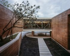 This art museum is located on the outskirts of Jingdezhen, a city famed for its porcelain production, so architecture studio DL Atelier chose to use the local clay-heavy earth for its walls.
