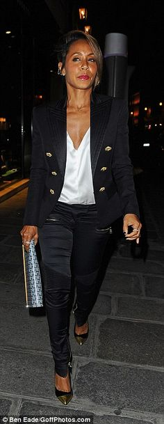Looking sharp: Jada showed off her chic sense of style in black skinny trousers and a gold-buttoned blazer