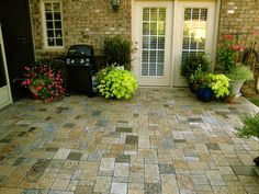 Recycled Granite Pavers...Love all the color in this patio!