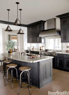 With its waterfront location, designer Susan Drake chose colors of driftwood and sand for a Stamford, Connecticut, kitchen. By rearranging the placement of appliances and furniture, Drake created a better place to cook and congregate.   - HouseBeautiful.com