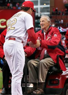 Cardinals manager Mike Matheny greets Stan Musial during player introductions before the Cardinals home opener against the Chicago Cubs Friday April 13, 2012 at Busch Stadium. Photo by Robert Cohen
