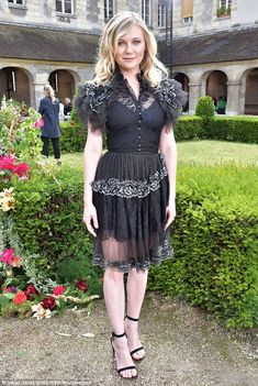 Licence to frill: The Fargo star was a sheer delight as she wore a frilly black dress, which had a cream lace trim