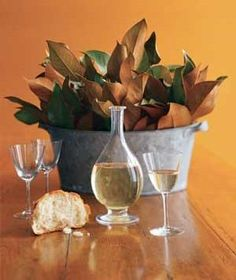 One-minute centerpiece: Fill a large rustic container with oversized dried leaves with various stem sizes.