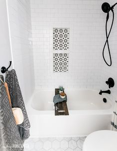 If you're looking for shower tile ideas, you're going to love this modern farmhouse bathroom remodel! It features white subway tile above the bath tub and has a cute shower niche with trendy black and white cement tile. I also love the boho shower curtain Bathtub Remodel, Shower Remodel, Boho Bathroom, Small Bathroom, Bathroom Black, Bathroom Mirrors, Bathroom Signs, Parisian Bathroom, Bathroom Cabinets