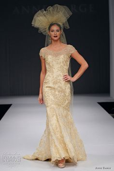 Gold--Pembroke mermaid shape gown with bateau neckline and cap sleeves in gold Alencon lace over silk charmeuse.