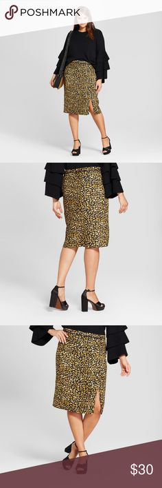 "New WWW Plus Size Animal Print Mix Pencil Skirt D3 Animal print steps into the limelight in the Capsule Leopard Pencil Skirt - Who What Wear™. So fun mixed with intense color or unexpected contrasting prints, our leopard print basic is great with a bold graphic tee and weekend sneakers, or dressed up as the focal point with all-black elements.  available in size 22W | 24W new without tags color: yellow cheetah (gold | black)  @cjrose25  Plus sizing: Model is 5' 9.5"" height/size 18  Black top…"