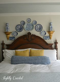Delightful gallery wall filled with blue and white china at Slightly Coastal--love it!