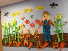 Autumn Bullitin Board with fingerprint corn, Popsicle stick pumpkins, carrot sewing project and fall leaves