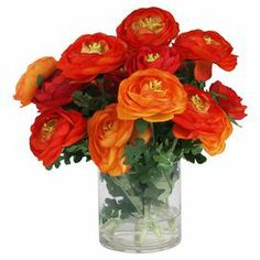 """Add natural appeal to your decor with this faux ranunculus arrangement, showcasing eye-catching blossoms in a glass vase.    Product: Faux floral arrangementConstruction Material: Silk, plastic, acrylic and glassColor: Red, orange and greenFeatures: Includes faux ranunculusDimensions: 13"""" H x 16.5"""" DiameterNote: Suitable for indoor use only"""