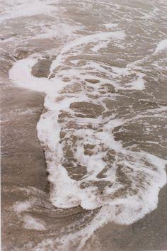 Ana Mendieta, Silueta series using powdered red pigment along the shoreline, 1976 (La Ventosa, Mexico). 35 mm colour slide.