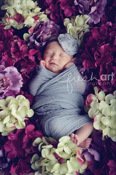 Baby girl when she was 8 days old.  I used the flowers later for a center piece on my a table.