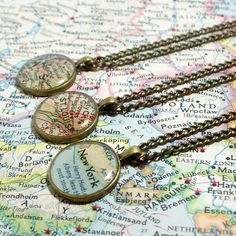 "This would be a great DIY ""charm"" necklace - group all the cities loved ones live in, or places you've traveled.  Using the Book Page Necklace Tutorial, http://pinterest.com/pin/154740937166462240/"