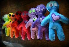 A rainbow of vodoo dolls.  Wenn's Weird Creations on Etsy.