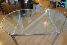 Polished Chrome & Glass Oval Dining Table | From a unique collection of antique and modern dining room tables at http://www.1stdibs.com/furniture/tables/dining-room-tables/