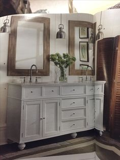 Vanity color/style, (maybe not those legs) and those mirrors 😍 - taken from home decorators collection magazine