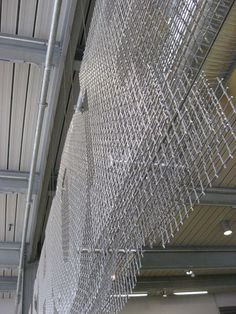 Up close, the multiple layers of various lock crimp wire mesh are visible. Straight rods running through the mesh anchor the layers evenly.