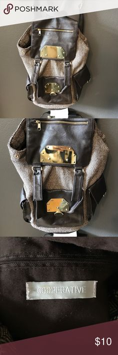 """Urban Outfitters backpack Urban Outfitters """"Cooperative"""" backpack. This has been used multiple times. It has come in handy for me many many times. The left strap has a minor tear, but overall it is still in awesome shape. Urban Outfitters Bags Backpacks"""