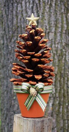 Glittered Holiday Pinecone Tree craft in Russett large #pinecone #tree #christmas www.loveitsomuch.com