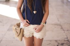dark blue shirt, lace skirt and gold locket with beige sling