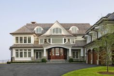 I love this front view. It has a grand scale, but still doesn't feel like a 'McMansion'. It has sort of a New England / Hamptons vibe.