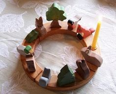 The Birthday Ring is a German birthday tradition. It is a symbolic way to celebrate the anniversary of a child's birth and show reverence for each year of their life thus far. A Birthday Ring consists of a wooden circle with holes representing each year of life.  Traditionally, on your child's first birthday, you place one candle on the ring and fill the rest of the holes with figures. On each consecutive birthday, you replace one figure with a candle.