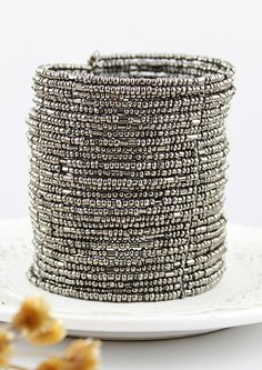 Silver Multi-layers Bead Bracelet silver lined clear seed beads on big coil of memory wire? Could try this idea.