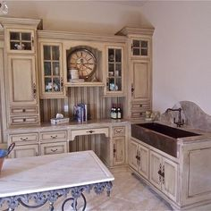 cabinets, love the style but not the color and the sink needs to be on outer wall with a window to look out..