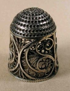 Early in the 18th century, in England, filigree thimbles were 'short'
