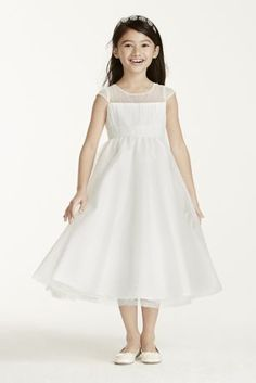 Delicate and sweet, this cap sleeve tulle dress is the perfect option for any flower girl!  Illusion cap sleeve bodice features all over dot tulle detailing.  Ruched waist and full ball gown skirt finish off the look.  Available in Soft White and White.  Fully lined. Back zip. Imported. Dry clean.