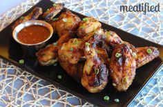 Paleo Glazed Chicken Wings from http://meatified.com. This glaze is fruit based, which means there are no added sweeteners! #paleo #whole30