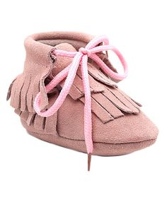 Supple suede cushions petite feet in these charming booties adorned with fringe.