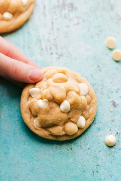 The BEST EVER white chocolate macadamia nut cookies with soft and chewy centers and crisp edges. Delicious cookies that the entire family will love!