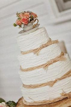 The topper is undeniably adorbs! Love the raffia, too.