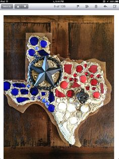 Rustic Texas wall decor with cast iron star and cast iron bottle opener. Variety of glass. Wood, stain, and cast iron. Measures 22 inches tall by 23