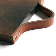 This cutting board is a true work of art, and is the perfect complement when serving fine cheeses or charcuterie. Handmade in Brooklyn by Pernt, the board is made of American walnut or white oak, has a hand-finished saddle leather handle, and finished with brass screws. Available in four sizes. White oak variation not pictured.