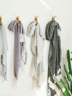 throw blankets hanging from leather and wood pegs / sfgirlbybay