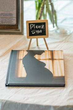 Mod(ern) Baby Shower - Make guestbook out of maternity photoshoot pics