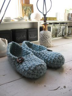 Knitted slippers: I love the chunky yarn and the big button.  Nice and easy, very, very pretty.