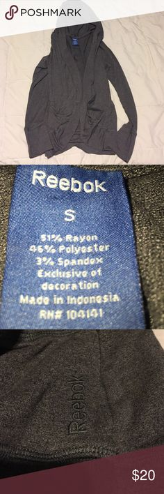Reebok hoodie Practically brand new! Only worn once! It's an open hooded cardigan. Dark grey color, charcoal. Reebok Tops Sweatshirts & Hoodies