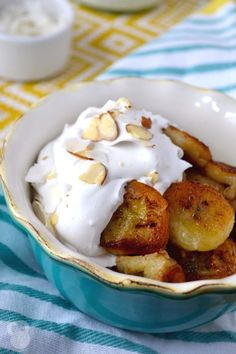 These pan-fried bananas are cooked in coconut oil and honey, and topped with a simple coconut cream made from coconut milk. They're SUPER delicious, and SO easy to make!
